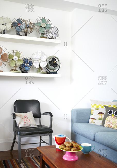 Fan collection on shelf