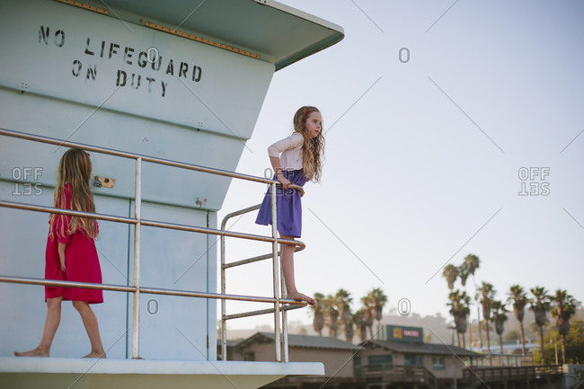 Two little girls playing on lifeguard tower