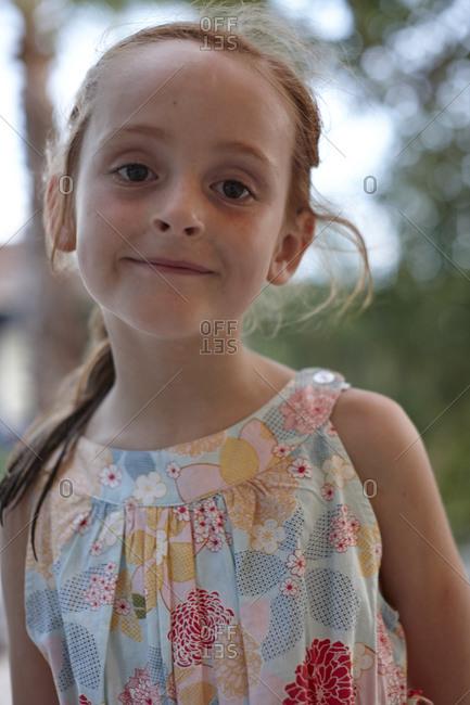 Smiling girl in summer dress