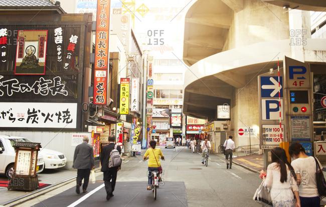 Japan - July 29, 2014: Japanese people walking on the street