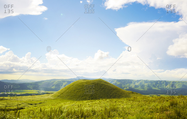 Tranquil landscape with mountain range in the background