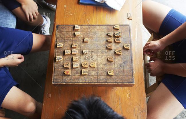 High angle view of young adult playing Shogi game