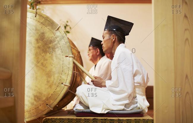 Miyazaki, Japan. - August 1, 2014: Man playing drum at a Kagura performance