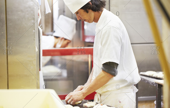 Kanagawa, Japan - August 13, 2014: Chef preparing pastry in a restaurant