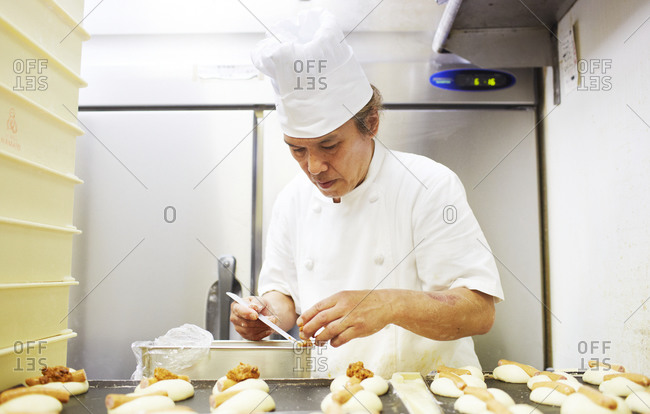 Kanagawa, Japan - August 13, 2014: Chef preparing pastry in a kitchen