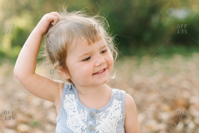 Portrait of a young girl touching her hair