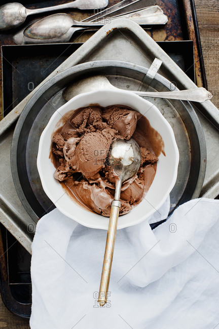 Bowl of chocolate ice cream on a pile of pans