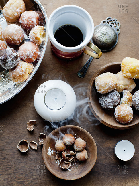 Nuts accompany a serving of donuts and coffee