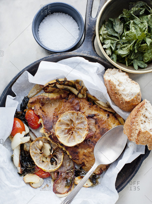 Roast meat and vegetables in a pan