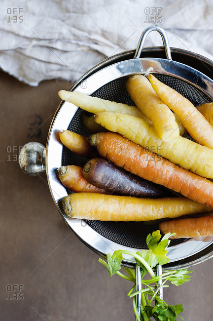 Roasted carrots on a strainer
