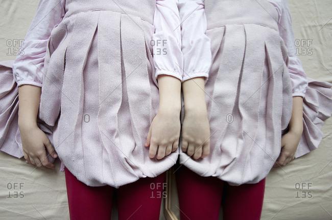 A girl lies next to a mirror