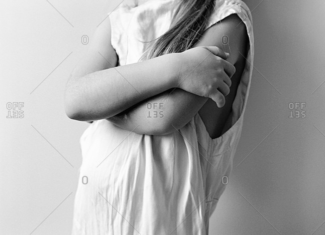 A girl crosses her arms