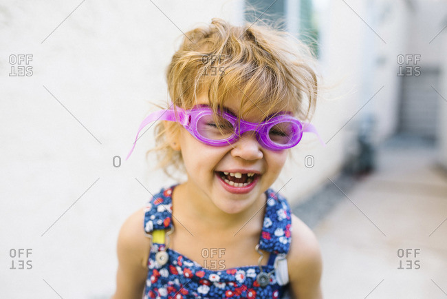 A girl in goggles giggles