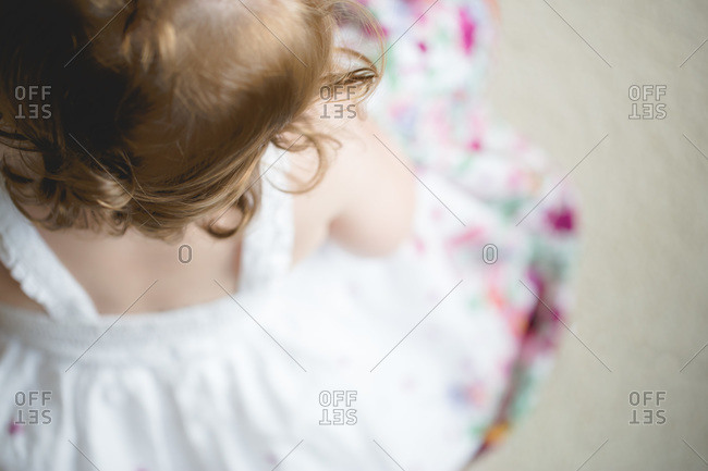 Overhead view of little girl in summer dress