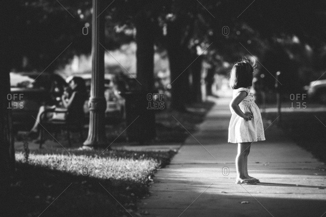 Young girl standing on the street