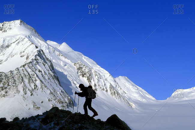 Silhouette of a hiker in the Concordia region of the Bernese Alps, Berner Oberland, Switzerland