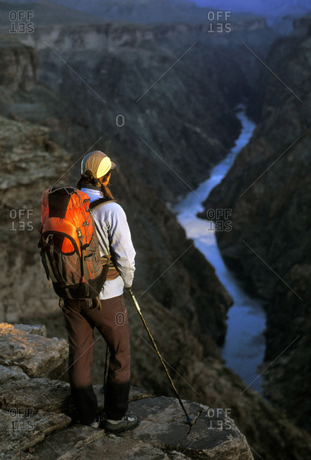 Woman looking into the Grand Canyon, Arizona, USA