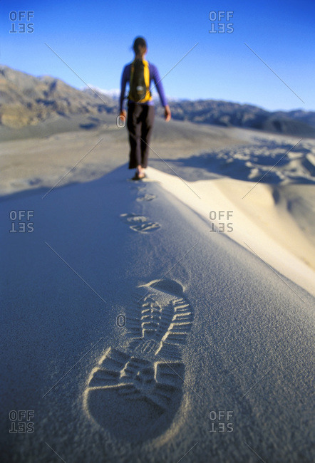 Woman hiking on sand dunes of Death Valley, California