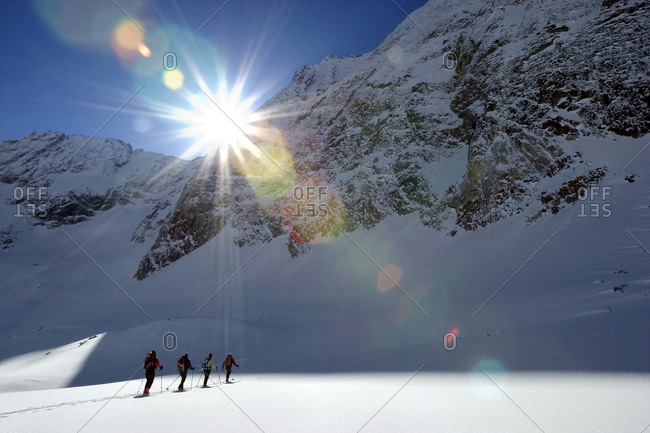 Skiers ascending the mountain on the Haute Route, Wallis Alps, Switzerland