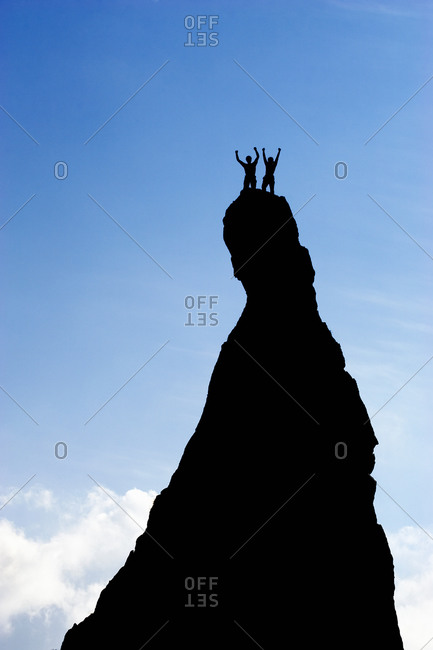 Successful climbers with arms raised in triumph, on the Aiguillette d'Argentiere