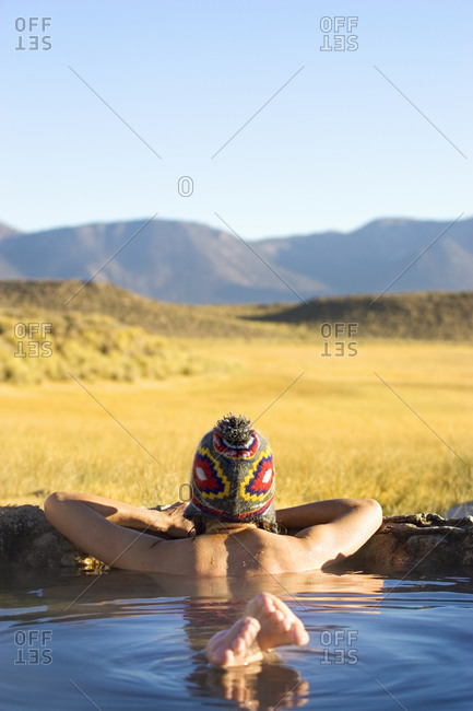 Woman resting in hot spring, Eastern Sierra, USA