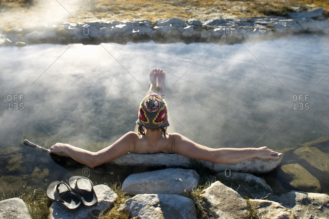 High angle view of woman resting in hot spring pool, California, USA