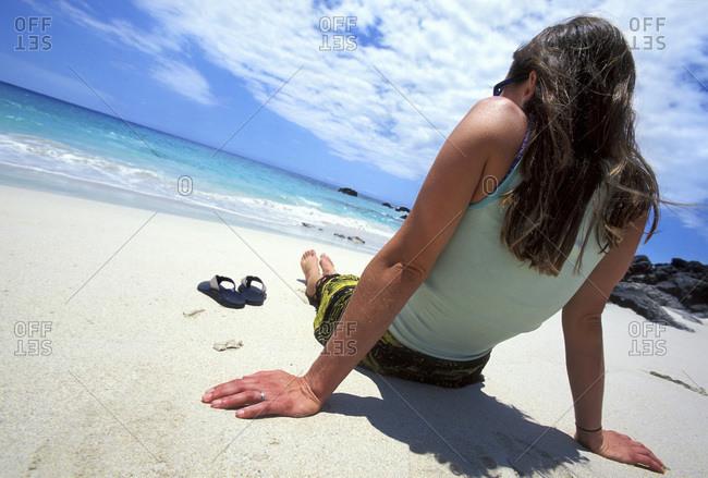 Woman relaxing on Hawaiian tropical beach
