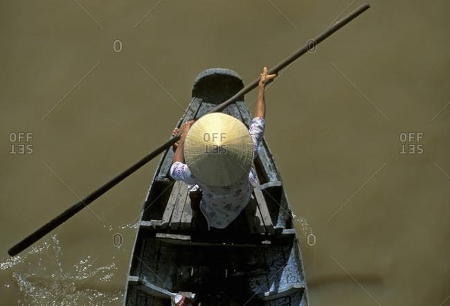 Person paddling on the Mekong River Delta, Cai Rang, Can Tho, Vietnam