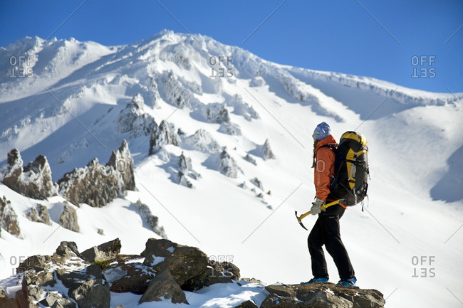 Woman standing at Mt. Shasta looking up towards the summit in California, USA