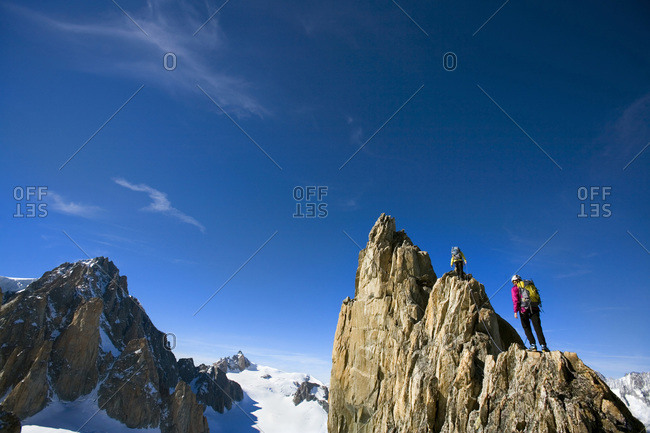 People hiking at the Aiguille d'Entreves in the French Alps
