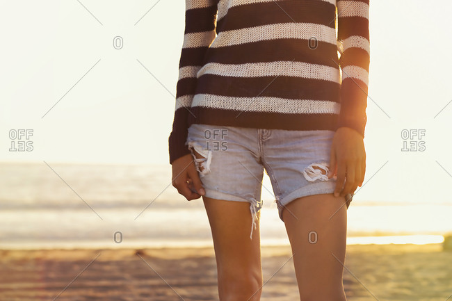 Midsection of a woman on a beach