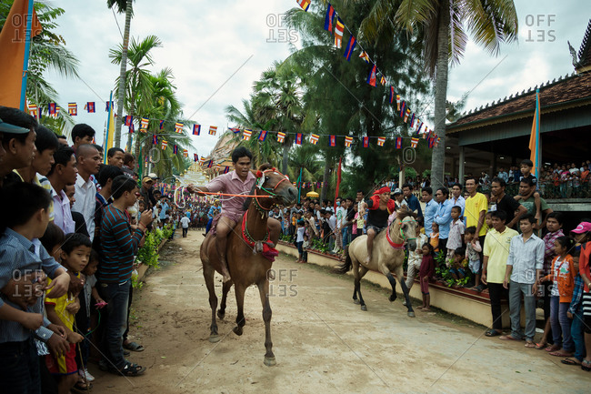 Vihear Suor, Kandal, Cambodia - October 4, 2013: Cambodians racing horses in festival