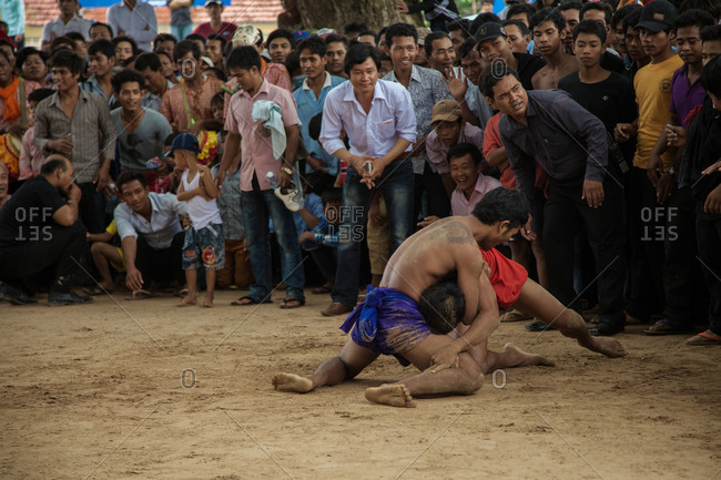 Vihear Suor, Kandal, Cambodia - October 4, 2013: Cambodian wrestlers in  a hold