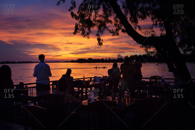 Tourists in Laos admiring sunset