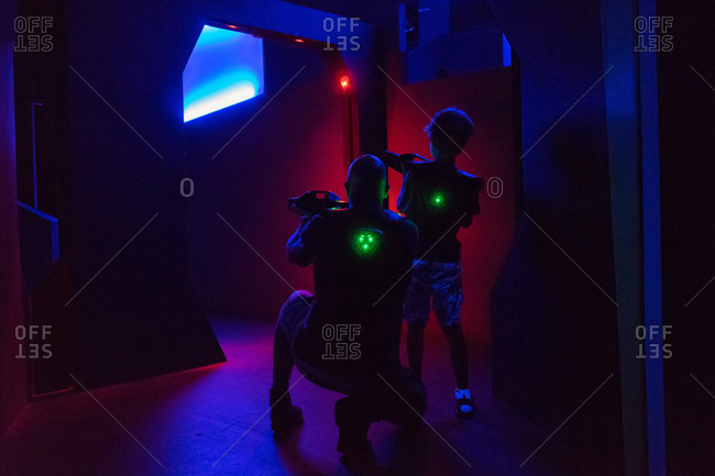 Father and son playing lasertag