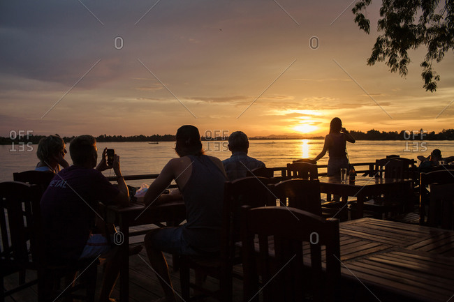 Tourists admiring sunset in Laos