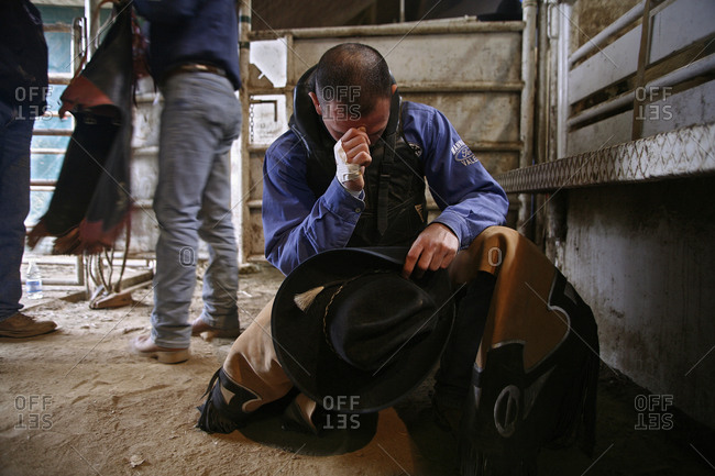 Voghera, Italy - March 25, 2007: Cowboy praying before the rodeo in Voghera, Italy