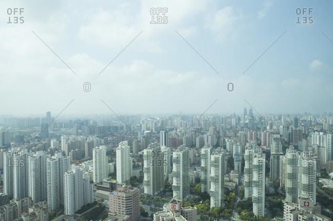 Buildings spread across an expansive city landscape