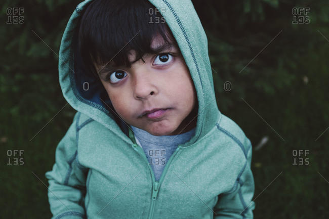 Young boy in hoodie outside