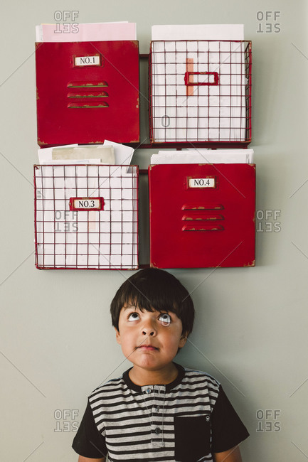 Boy underneath wall organizers
