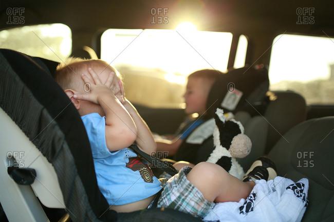 Two little boys in car seats