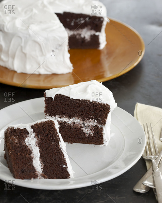 A chocolate cake with two slices removed