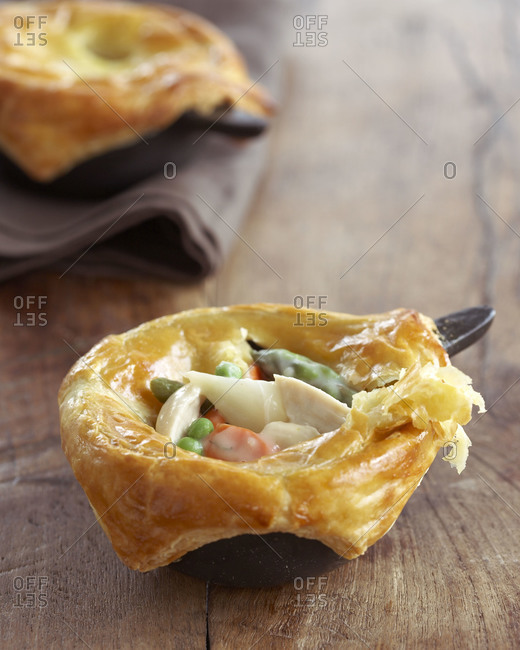Two chicken pot pies on a table