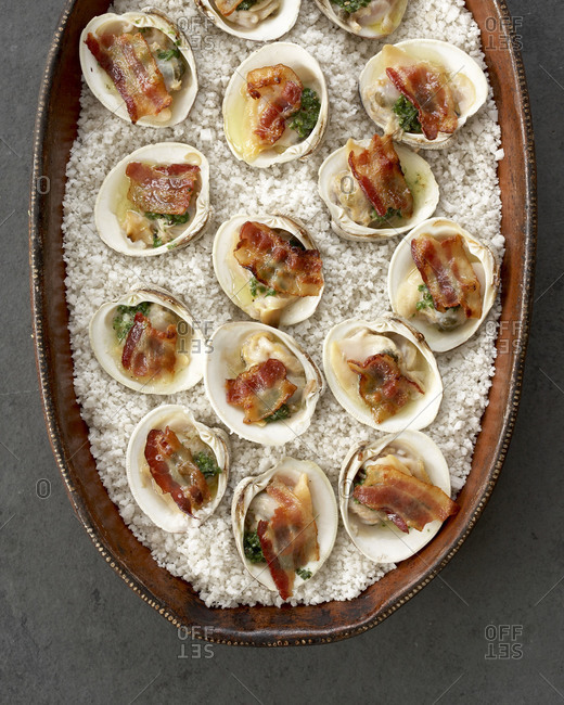 Clams casino served in a wood platter