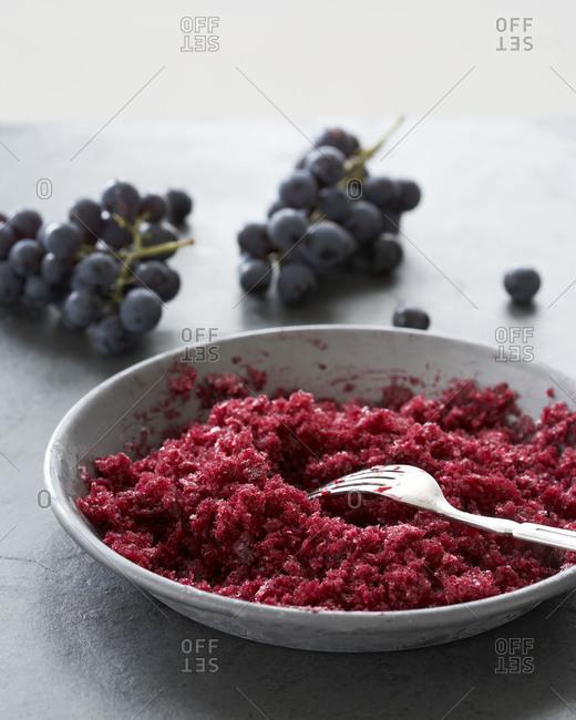 Red grape granita served in a bowl