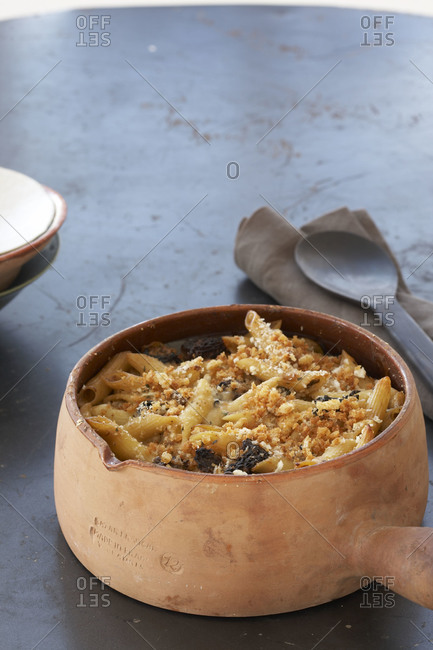 Macaroni and cheese in a terracotta serving bowl