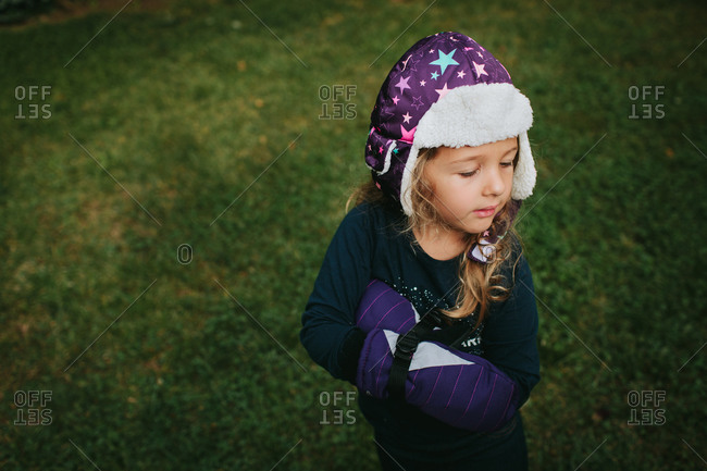 A young girl wears her winter gear