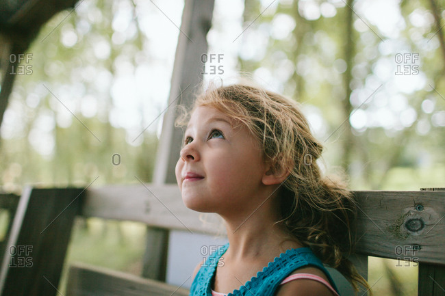 A girl looks up into the sky