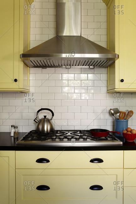 Range hood in yellow kitchen