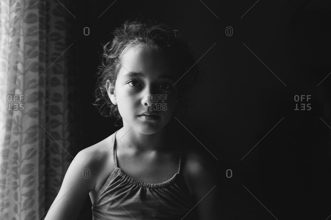 Portrait of a girl next to window